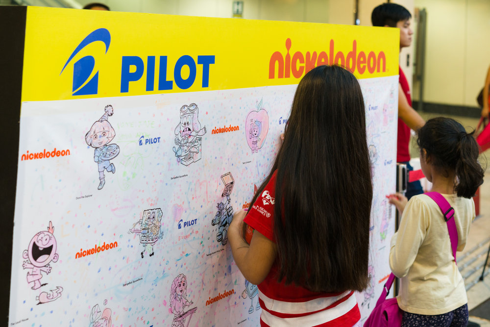 218240 two%20girls%20use%20pilot%20pen%20frixion%20stamps%20to%20decorate%20the%20stamping%20wall%20at%20nickelodeon%20slime%20cup%202016%20in%20singapore%20at%20city%20square%20mall%20(credit%20 %20nickelodeon%20&%20aloysius%20lim) 4ac0ae large 1468802900