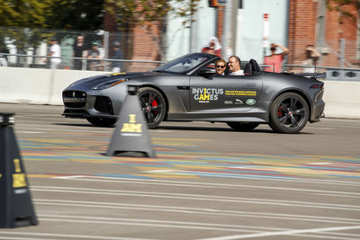 259297 12 prince harry drives with german competitor dennis siesing during the jaguar land rover driving challenge at the invictus games 727a97 medium 1506438931