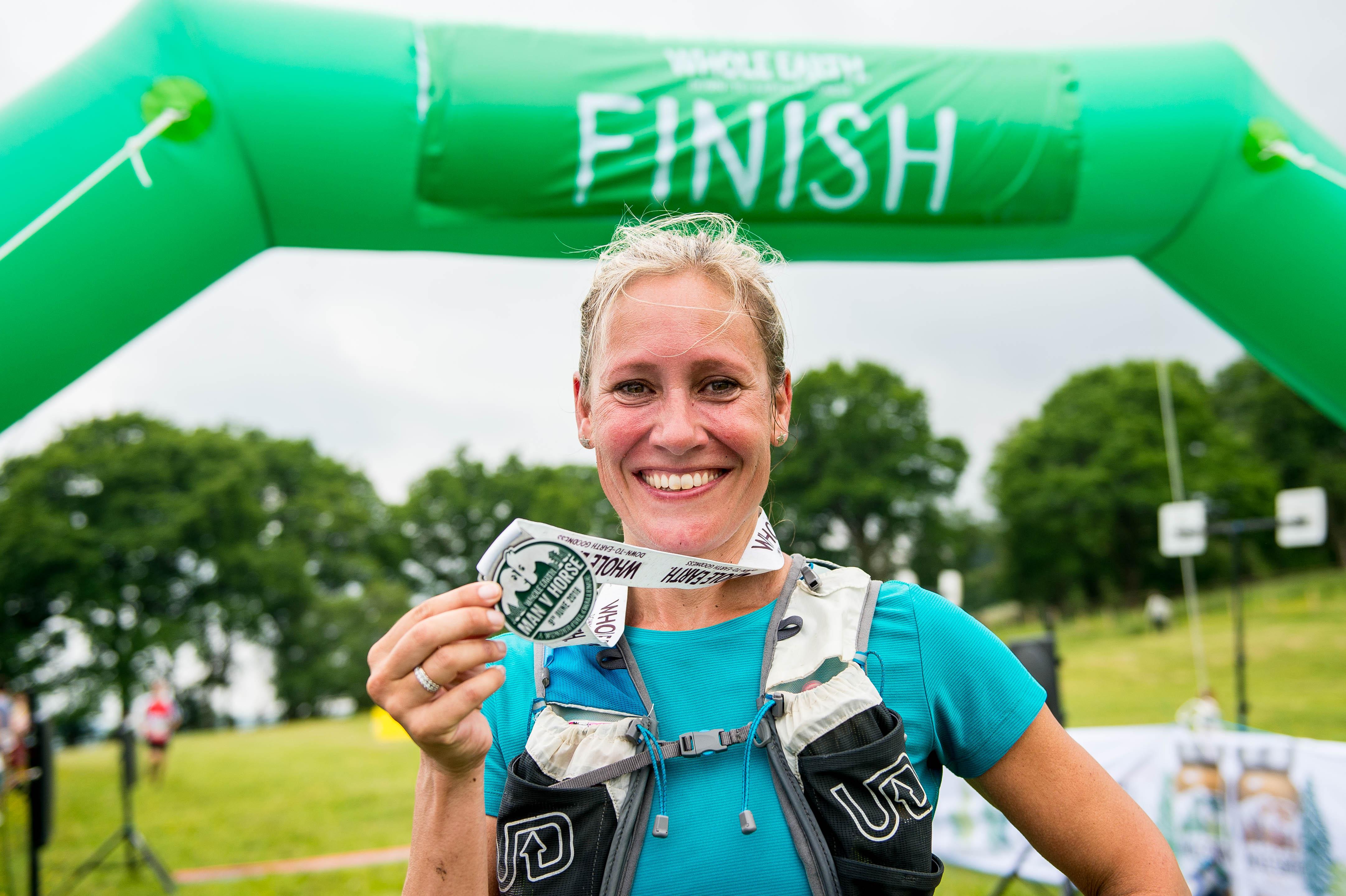 Sophie with medal finish line.jpg