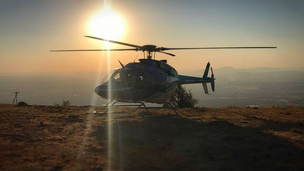 267227 helicopter on a cliff at sunset 018536 large 1513005689