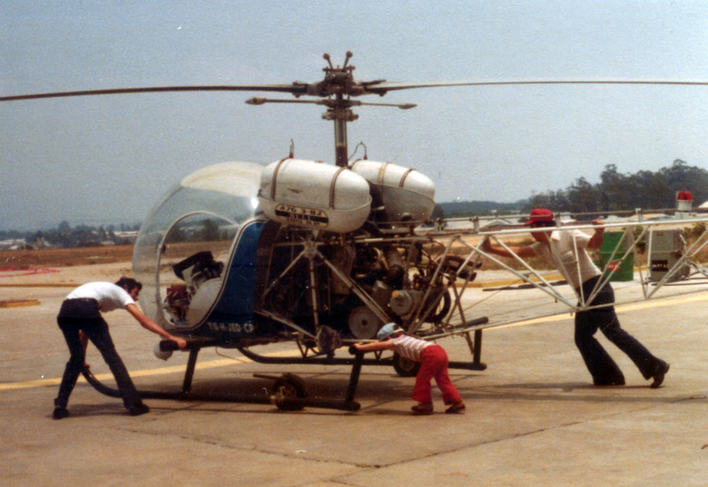1978 - GG Sr on right- GG jr middle with Bell 47.jpg