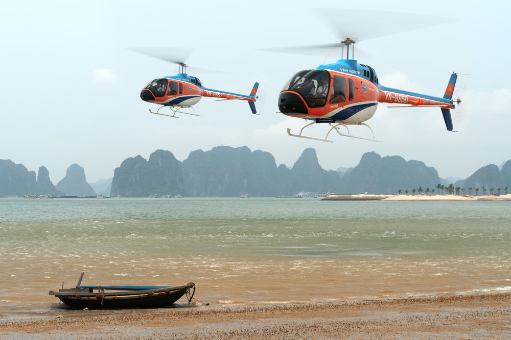 VNH North Bell 505 helicopters in Ha Long Bay.jpg