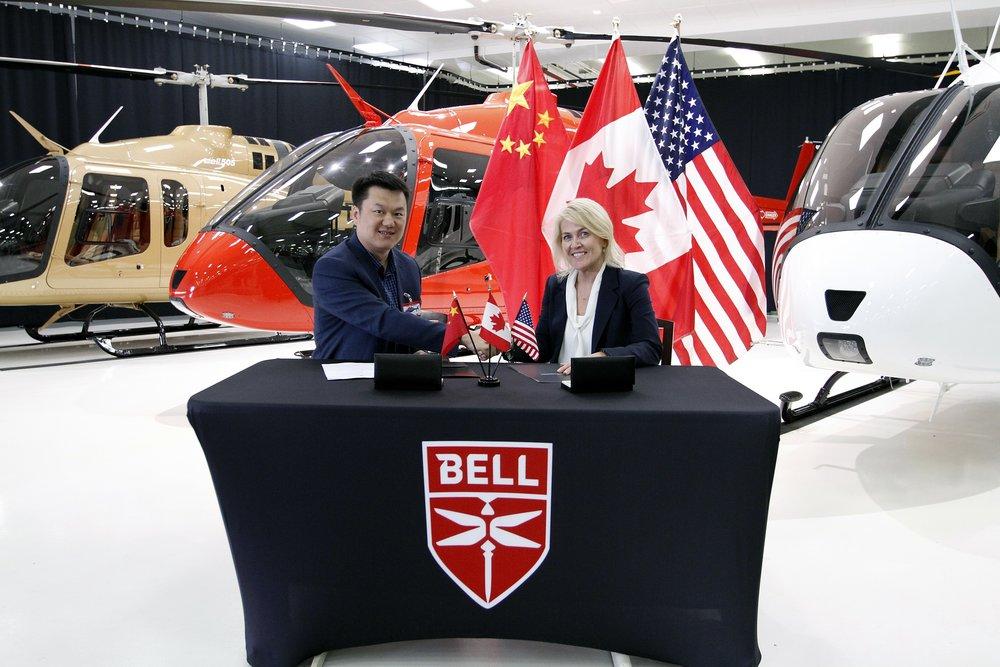 George Geng, President of Reignwood Zhuhai and Cynthia Garneau, President of Bell Canada.jpg