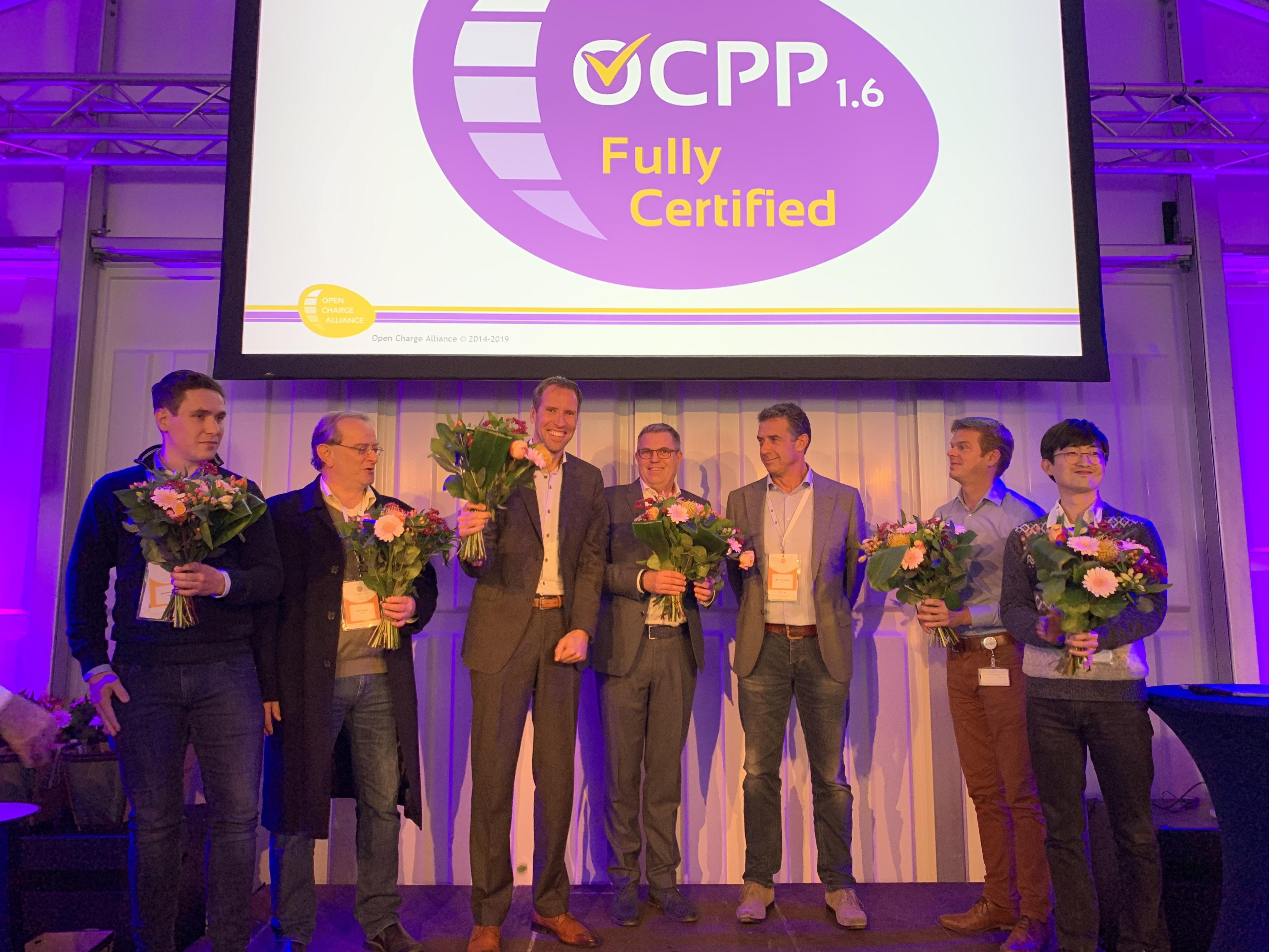 Arjan van Rooijen (CTO of EVBox) receives the OCPP 1.6 certificate on stage