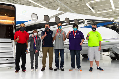 Textron Aviation President & CEO Ron Draper (pictured third from left) with Special Olympics Kansas athletes