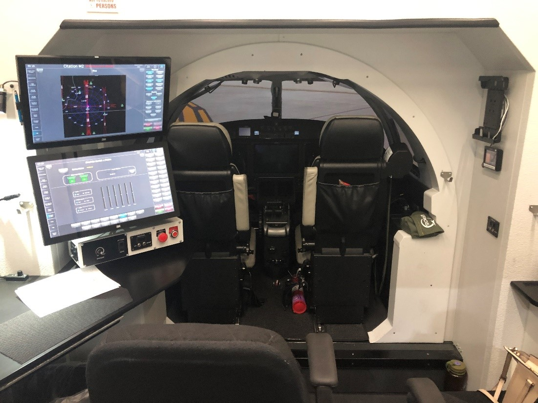 The simulators have cockpits that are identical to real aircraft.  The cockpit is accompanied by realistic visuals out of the windscreen.